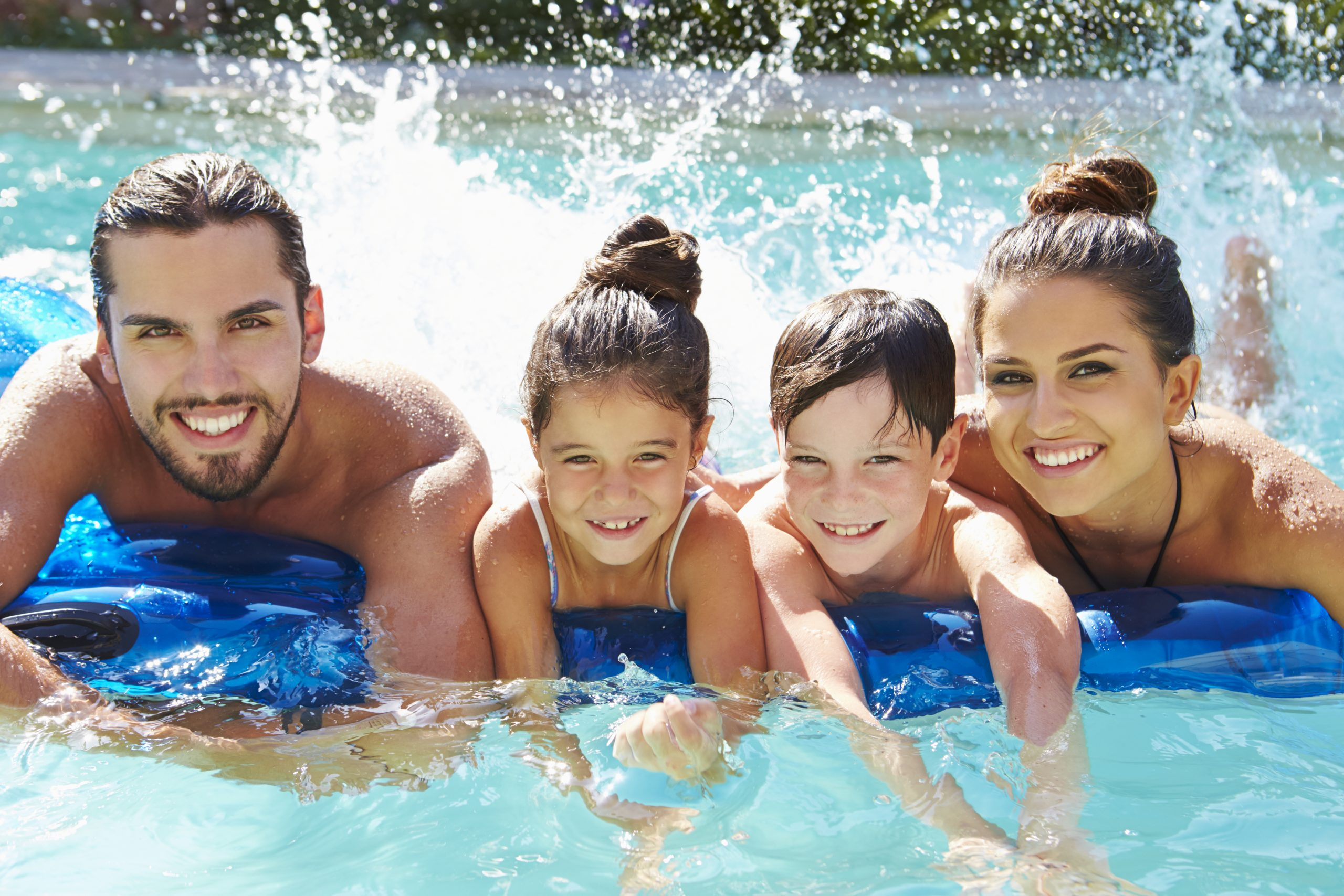Family Swimming In Saltwater Pool