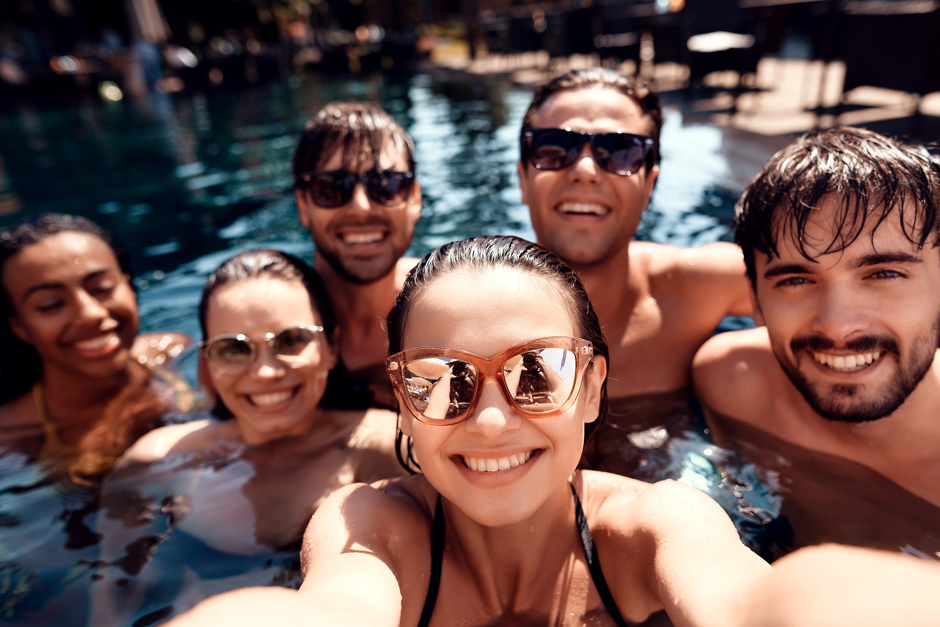 Summer vacation friends together at swimming pool party. Swimming pool party.